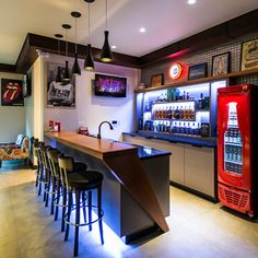 Installing a bar in your home is a great way to make sure that when you have company over everybody has a fun place to spend time together. A dedicated bar spac Basement Bar Designs, Home Bar Designs, Basement Ideas, Mini Bars, Man Cave Bar, Home Bar Areas, Modern Home Bar, Man Cave Basement, Cozy Basement