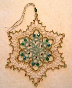 """Green & Gold snowflake"" project tatted by intatters member IdahoCanuck. Design by Jan Stawasz - Doily VIII Motif (pg 46-47) found in his second book, Tatted Treasures."