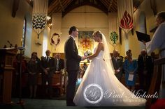 Exchanging vows in St Michaels church. New Zealand wedding photography http://www.paulmichaels.co.nz/ PaulMichaels Wellington photographers.