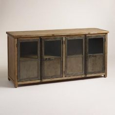 With glass paned metal doors, a wood frame and latch closures inspired by cargo trucks, our mixed-material cabinet exudes an industrial air. It features four generous shelving compartments that are ideal for storing electronics as a media unit, or dinnerware as a buffet.