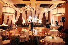 Custom lounge with draped ceilings and walls, pendant chandeliers, custom projections, tall bar and cabaret seating in Hualalai Ballroom.  Four Seasons Resort Hualalai Weddings
