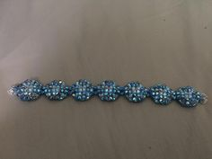Grecian Goddess Bracelet made with Air Blue Opal ABx2 4 mm for the main color and White Opal ABx2 4mm color for the middle beads. A silver tone w/ tiny clear crystals,round magnetic clasp was used.
