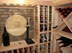Wine Cellar Design Ideas cool wine racks set against a stone backdrop give this cellar an artistic appeal Small Wine Cellar Design Ideas Pictures Remodel And Decor Page 15