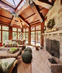sun room - love the woodwork and stone