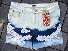 Upcycled jeans shorts by 16-year old designer Sophia Scanlan for Stubborn Jeans. Lace on tri-level bleached.