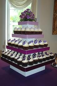 Cupcake tower make with foam blocks, cardboard papered, ribbon, hot glue gun and wedding wrapping paper.