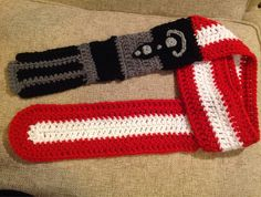 Darth Vader lightsaber crochet scarf by TripleStitchSisters on Etsy https://www.etsy.com/listing/181105055/darth-vader-lightsaber-crochet-scarf