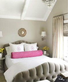 I love this gray tufted bed frame paired with pops of pink and white linens.  We added a chandelier and sconces for reading light.