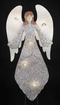 white and silver glittered lighted outdoor angel