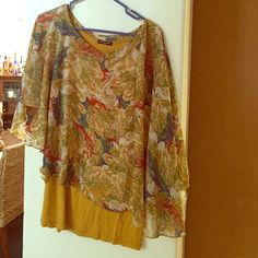 Top Size XL top mustard color no sleeves with sheer colorful overlay that covers arms. Tops Blouses