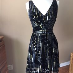Anthropologie Eva Franco Dress Black Hold Silver Black dress with gold and silver threads, and black velvet-like flicking. Side zipper, lined, self belt. This is a really striking dress. Shown on size 6/8 mannequin (mannequin measures 37-26-37)Check out the $6 section of my closet (before the sold items). Lots of bundle-worthy $6 items! 15% bundle discount on 2+ items in a bundle.NO TRADES Anthropologie Dresses