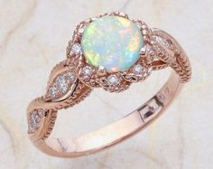 Image result for opal and rose gold engagement rings