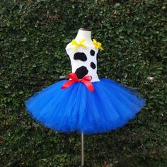 Jessie from Toy Story Inspired Tutu Dress This beautiful Jessie Inspired Tutu Dress is made with royal blue tulle, white tutu top with black cow hyde, red bow and whites straps with yellow bows. The T
