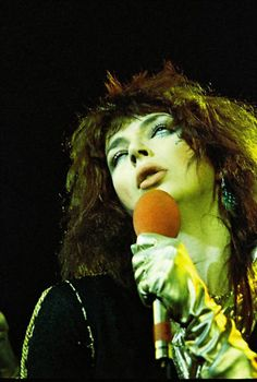 """Kate Bush performs """"James and The Cold Gun"""" during one of her 'Tour of Life' concerts, 1979."""