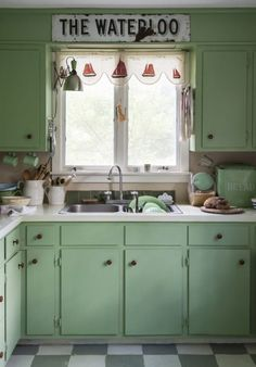 6. Reinvent your kitchen with paint. Farrow & Ball's (farrow-ball.com) Folly Green paint transformed a 1970s being kitchen here. Bistro curtains are an Ian Mankin (ian-mankin.co.uk) stripe called Odeon. The vinyl floor has been painted with a grey and white check. Picture: Matthew Williams