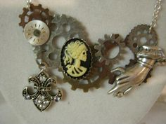 Steampunk Skull Cameo Gear In Hand Necklace by jansbeads on Etsy, $30.00