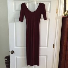 "Burgundy bodycon dress This fabulous dress hugs you in all the right places! Only worn once, only washed once. Its just like new. Material is nice & thick, so its great for the fall! I'm 5'7"" & the bottom hits at my calves. Not from listed brand. Zara Dresses Maxi"