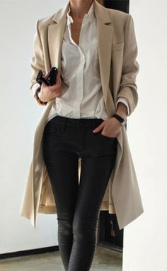 classic look. Long coat to hide a larger bottom. Can find a coat with a flair. Tight jeans or in this case jodhpur pants. Love the tan, black and white color combo. can be worn with high boots too.