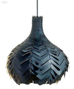 Pod Noir pendant in vegetable-dyed kangaroo leather by Who Did That.