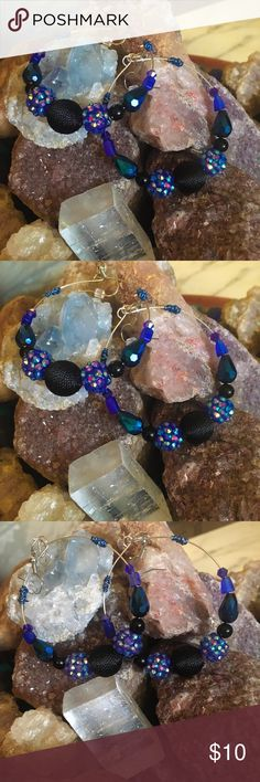 Beautiful beaded hoop earrings! Beautiful beaded hoops in variations of blue, constructed on memory wire. Jewelry Earrings