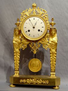 Antique French Directoire Goute D'Egypt ( Egyptian style) ormolu mantel clock. - Gavin Douglas Antiques