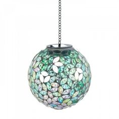 Shades Of Green Solar Mosaic Ball - Lovely shades of green will dazzle you by night when you hang this mosaic ball on your porch or patio. It features a solar panel that soaks up the sun's light all day long and one rechargeable AA battery inside helps it glow at night. It hangs from a fine metal chain.