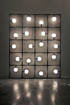ATELIER ARETI, SQUARES: 20 squares and spherical bulbs lit by LEDs. (Dunno where but could do something like this in an outdoor entertainment area)