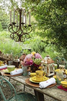 rustic outdoor dining with a chandelier