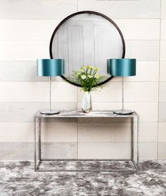 Madison table lamps in Antique Silver, Madison round mirror with an Antique Bronze finish on a Siena console table with an Antique Silver finish and Rosso Luna marble top.