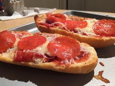 Pizza Bread - We make this a lot, except we usually use French bread and cut it into portions. This idea looks very handy and cute. I've noticed that it always tastes better with a thin layer of either butter or olive oil on the bottom, before everything else is added.