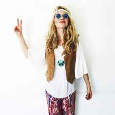 DIY Hippie: You can follow in the footsteps of this trippy-hippy with some Woodstock-era flowy pants, Lennon glasses, bell sleeves, and a vest.
