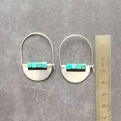 Tribu Collection  Silver hoop earrings. Half moon shape earrings. Sterling silver plaque and wire . Turquoise cubes. Natural stones. Natural silver without polishing.  Size: Length - 41 mm Width - 28 mm  Color: silver and turquoise.  Handmade jewelry - Handmade jewellery  Note: Silver darkens natur