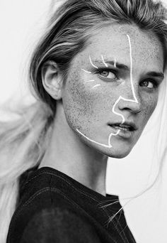 graphic white line make up, couture, high end fashion.