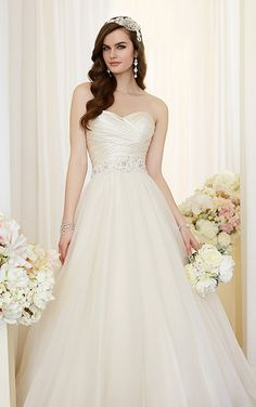 For brides looking for a fairy tale experience, this Dolce Satin and Tulle ball gown wedding dress from the Essense of Australia collection is the perfect choice.