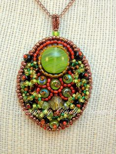 """Fan Dancer"" pendant by Cindy Caraway - jewelry, bead embroidery"