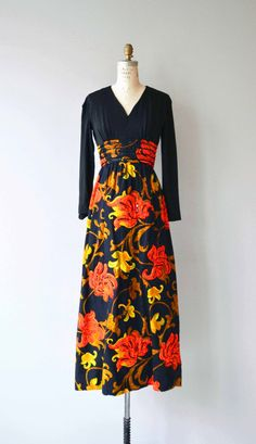 Vintage 1970s maxi dress with black jersey bodice, V neckline, long sleeves, cummerbund-style waist, long bright floral print skirt with trapunto blooms trimmed with sequins. Skirt is a thicker cotton-blend material.  --- M E A S U R E M E N T S ---  fits like: small shoulder: 15 bust: 33-34 waist: 26 hip: up to 44 length: 54 brand/maker: union made condition: excellent  To ensure a good fit, please read the sizing guide: http://www.etsy.com/shop/DearGolden/polic...