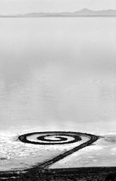 """""""Like most land art, the Spiral Jetty is a part of its landscape and its affected by the elements: It exists to eventually erode under natural conditions. Since its creation, the jetty has been completely covered and uncovered by water several times, being dependent on fluctuating water levels.""""  [some information about """"spiral jetty"""" series here; his films]  Robert Smithson, Spiral Jetty, Great Salt Lake, Utah; Photos by Stu Jenks"""