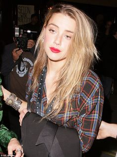 Getting back out there: Amber was also seen at London Fashion Week last month, having finally reached a $7million divorce settlement with Depp in August
