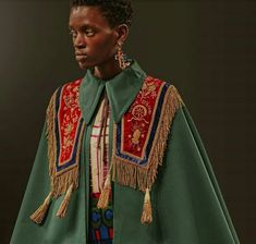 Inspired by sacred religious vestments, an embroidered velvet stole is placed over a cape coat and a skirt with new Gucci lettering for Gucci Cruise 2019 by Alessandro Michele. Space Fashion, High Fashion, Mens Fashion, Fashion Design, Character Costumes, Character Outfits, Costume Design, Fashion Advice, Fasion