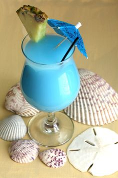 Blue Hawaiian cocktail drink recipe: blue curacao, rum, pineapple, coconut. http://mixthatdrink.com/blue-hawaiian/