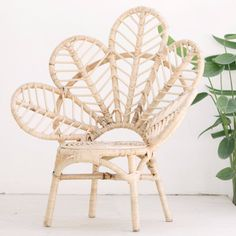 Mini Love Chair.  A statement piece in any child's room or nursery, this gorgeous and fun Mini Love Chair is exclusively for kids.  Fall in love with this beautiful rattan, hand made, flower petal chair. If you need one for yourself too, we also do a full size option for adults!