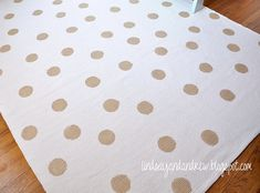 DIY polka dot rug, ikea rug and martha stewart metallic gold paint