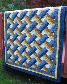 Twin Bed Quilt Weaver Fever pattern in blue by WarmandCozyQuilts