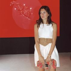"""""""I took this picture of # dasha zhukova at an #art #gallery in #london I like the #colors #red #black #white"""""""