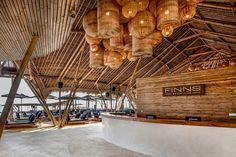 Bali Berawa's Beach Club Marries Traditional Style with Chic Design — molemole Bamboo Architecture, Architecture Design, Bar Bistro, Finns Beach Club, Yachting Club, Lodge Furniture, Bamboo Pendant Light, Sequoia, Resorts