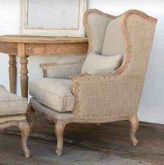 "The Rae is a Burlap & Linen Wingback Chair with exquisite nail head detail.  We couldn't have designed it better ourselves.The Rae measures 29"" x 27"" x 42"""