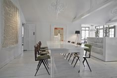 Can you believe that this artistic white dining room is in a 1930's hunting lodge in Connecticut?The chairs are a nod to the residence's past. The bedroom is also modern and white. A beautiful, artsy loft in Amsterdam. Notice the bedroom behind the curtains? You can see a larger view by clicking the image. The …