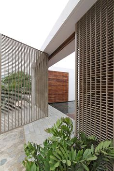 amazing coastal house design with concrete and natural building construction with white modern gate