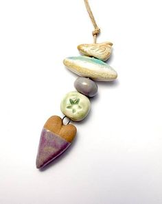 Beach Day… These hand formed ceramic beads are glazed in a garden of sweet pinks, purples and creams by Gaea Cannaday.