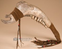 This is a unique Native American jaw bone tomahawk war club. This is an actual Native made tomahawk created by the famous Navajo Indians.This decorative tomahawk has a leather wrapped handle and is pe